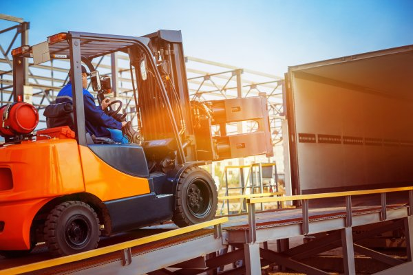 Man in forklift transporting goods