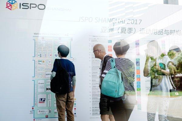 Visitors looking at the hall plan at ISPO Shanghai