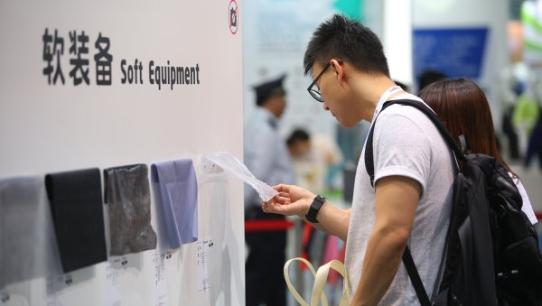 Man touching fabrics at ISPO Shanghai