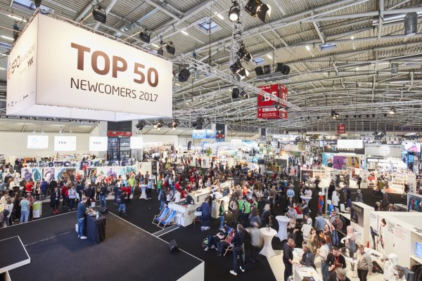 Many visitors in a hall of the Munich Trade Fair Centre during the ISPO.