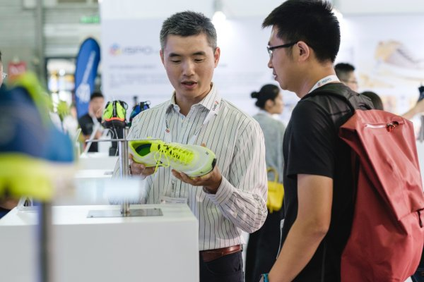 Visitors having a look at yellow sports shoes