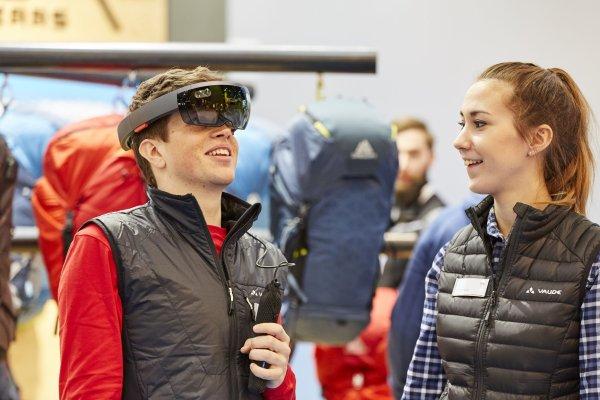 A participant is checking out VR at ISPO
