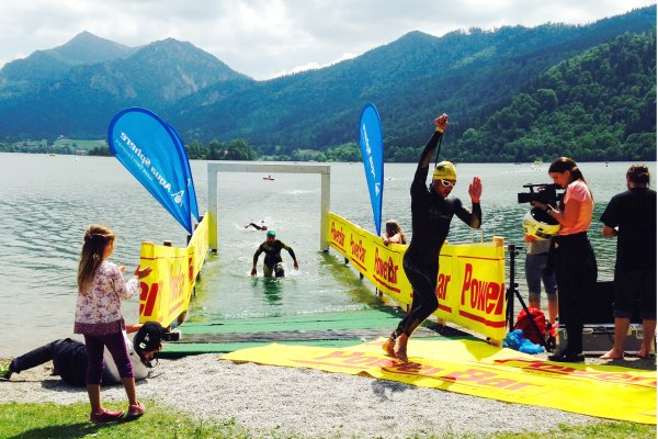 Participant of Schliersee triathlon in southern Bavaria while leaving swimming stage.