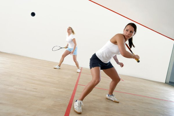 Two women playing Squash
