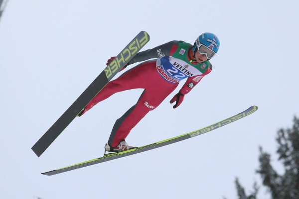 Ski jumper up in the air at the Four Hills Tournament