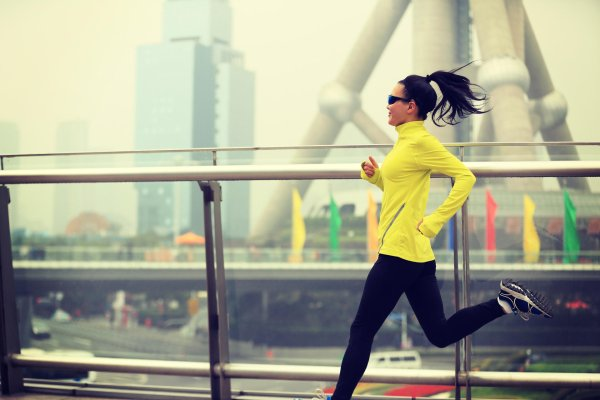 Chinese woman running in the city.