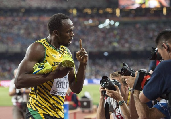 Dutifully keeping the Puma shoes in the frame: Usain Bolt is the sporting goods manufacturer's walking advertisement.