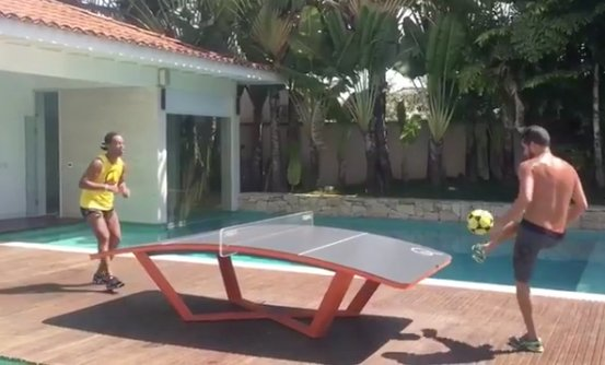 Ronaldo is playing teqball with a friend.