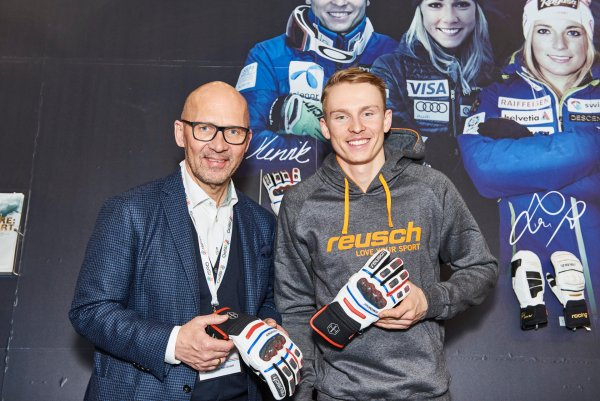 CEO of Messe München Klaus Dittrich with ski racer Henrik Kristofferson (right)