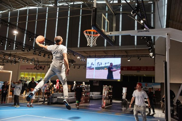 French-born Guy Dupuy shows off his slam dunk tricks to the audience at POLYGON.