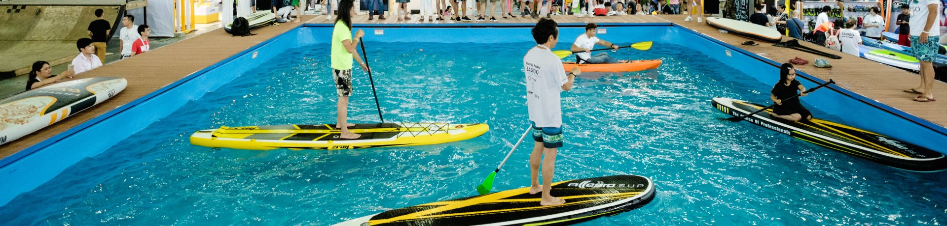 ISPO Shanghai Water Sports area, participants do stand-up paddling