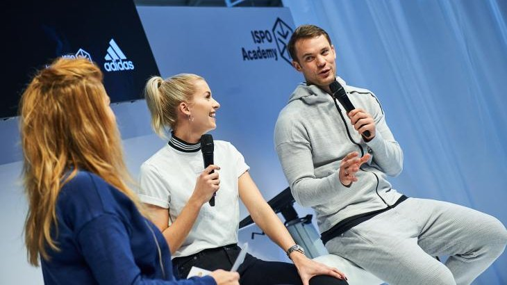 At the Adidas Symposium Manuel Neuer and Lena Gercke speak with moderator Isabella Müller-Reinhardt.