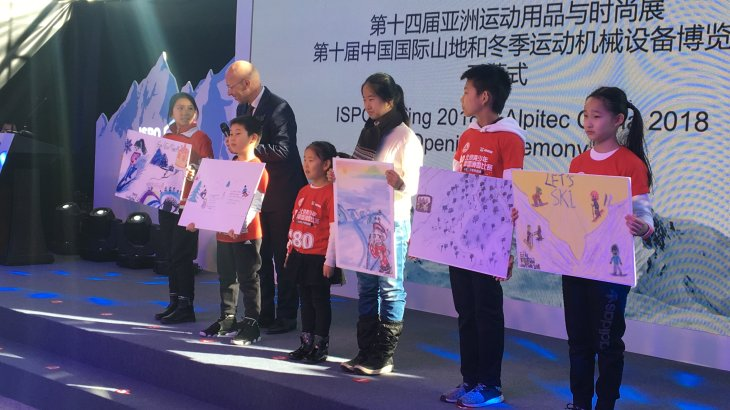 Young wintersport students of the Beijing Magic School are interviewed by Klaus Dittrich during the Opening Ceremony der ISPO Beijing 2018