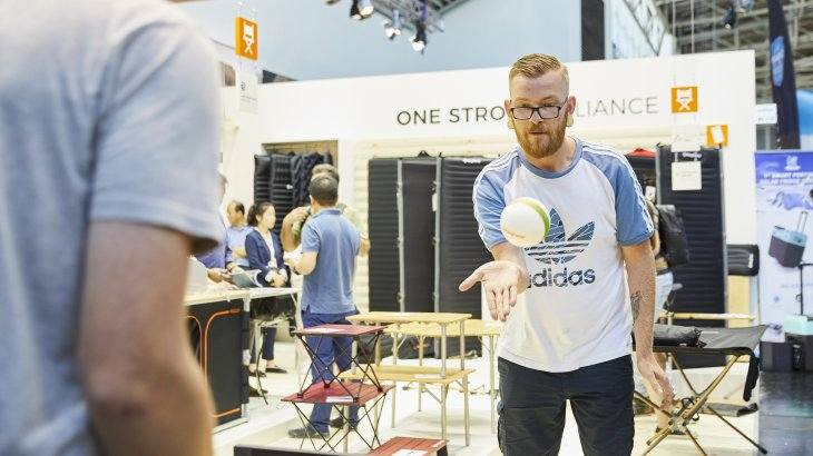 People trying ou table tennis at OutDoor by ISPO 2019.
