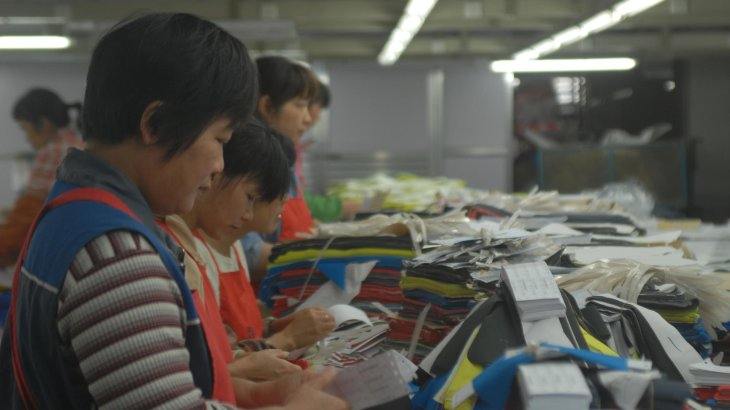 Workers at the KTC factory at work