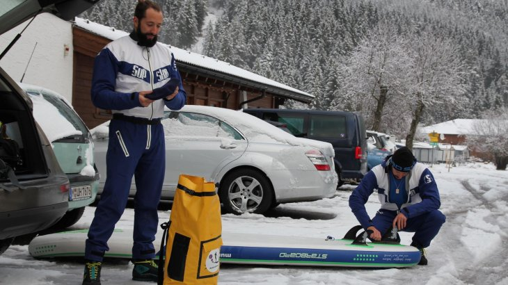 Mario (l.) and Manuel Stecher preparing for a ride on the slightly frozen Heiterwanger See in Tyrol