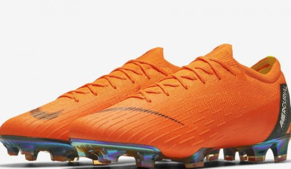 Orange football boot by Nike.