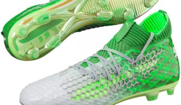 Green football shoes by Puma.