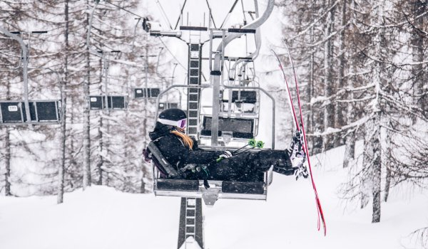 Birgit Ertl chilling on the lift with the new Mindbender skis.