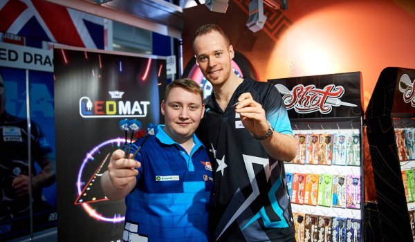 Darts players Max Hopp and Martin Schindler at the Shot Darts booth at ISPO Munich 2020