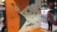 Hands on testing beats theory: That's why exhibitor Petzl built a boulder wall at its booth.
