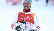 The Austrian Marcel Hirscher is pleased about his very first Olympic gold medal in the super combination. Soohorang celebrates with him.