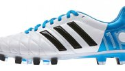 Blue and white Adidas adipure football boot.