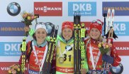 Often in the spotlight: Laura Dahlmeier with Justine Breiszas (left) and Marte Olsbu after her World Cup win in Slovenia – she's wearing the yellow jersey of the Overall World Cup leaders.
