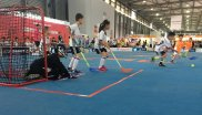 Floorball is a simplified version of field hockey for kids. It's played on a way smaller pitch and the ball is made from light plastic.