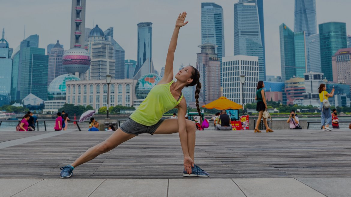 Making sports in front of skyline of Shanghai