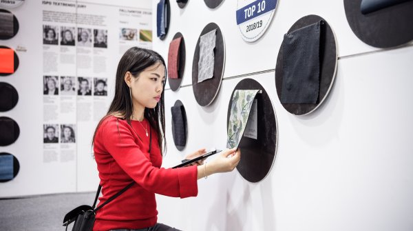 Woman touching fabric on ISPO Beijing