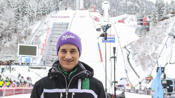 Schmitt in front of the ski jumping hill in Oberstorf