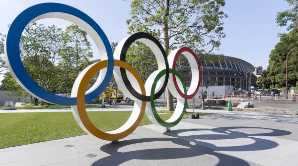 The Olympic rings in front of the new National Stadium in Tokyo - one of the sports venues of the Olympic Games.