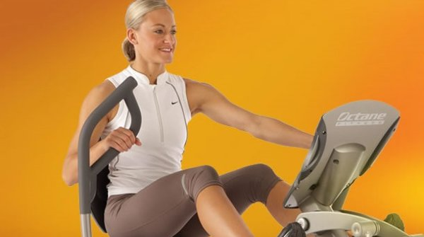 A woman trains on a crosstrainer