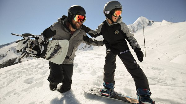 Tommy Delago, co-founder of Nitro Snowboards, together with his son to promote young people in action sports.