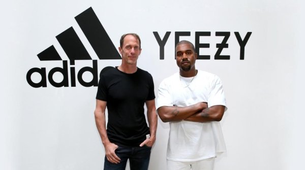 Member of the Executive Board of adidas Eric Liedtke (l.) and superstar Kanye West presenting the new project