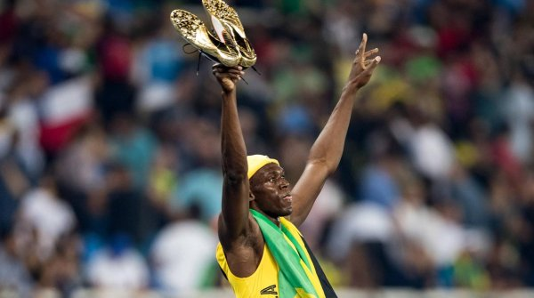 Usain Bolt lets his golden Puma shoes take center stage