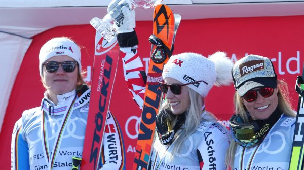 Viktoria Rebensburg (left), Eva-Maria Brem, and Lara Gut (right) present their ski manufacturers in the proper light on the podium.