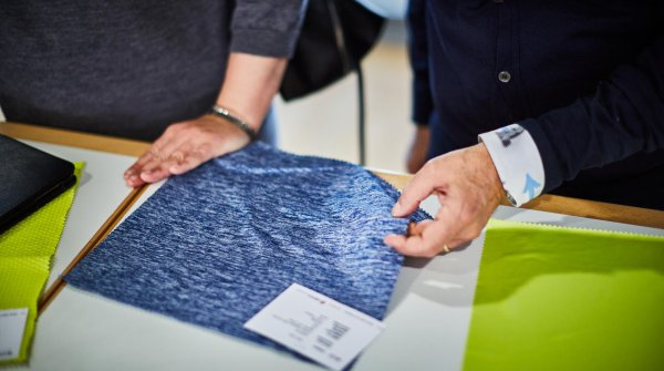 Touching the fabrics to get a feel for them is a key part part of the ISPO TEXTRENDS jury meeting.