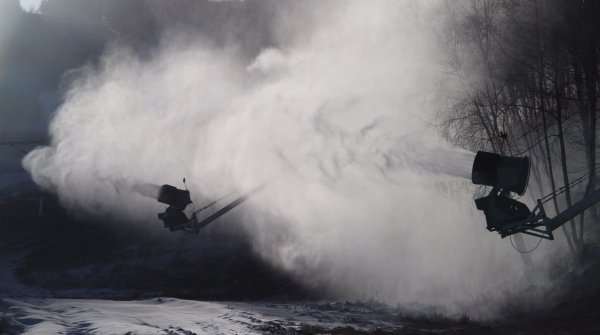 Fire away: In China, many ski areas are covered with artificial snow.