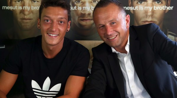 On the side of the national players: Oliver Brüggen (on the right), Adidas PR-head, with Mesut Özil, at that time still in Madrid announcing his adidas partnership.